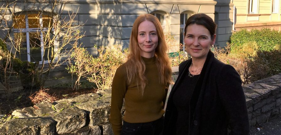 PhD candidate Hege Stein Helland and Professor Marit Skivenes in front of the Department building in Christies gate.